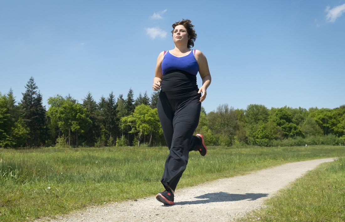 Woman outdoors running