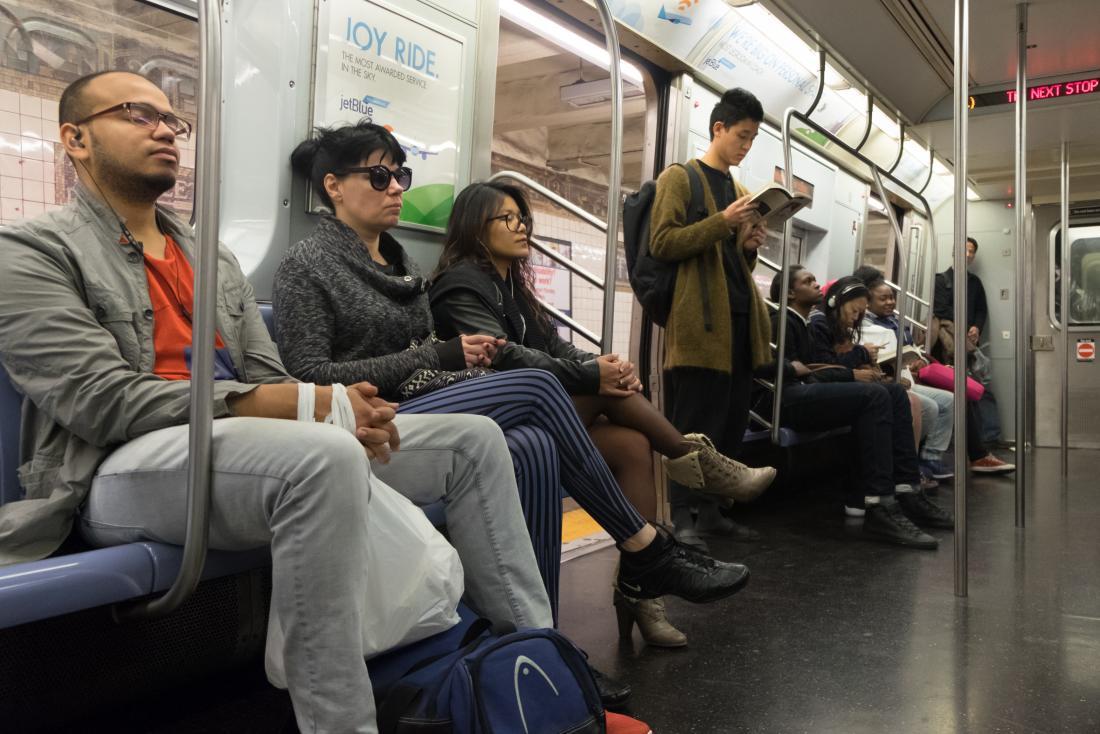 man sleeping on tube train
