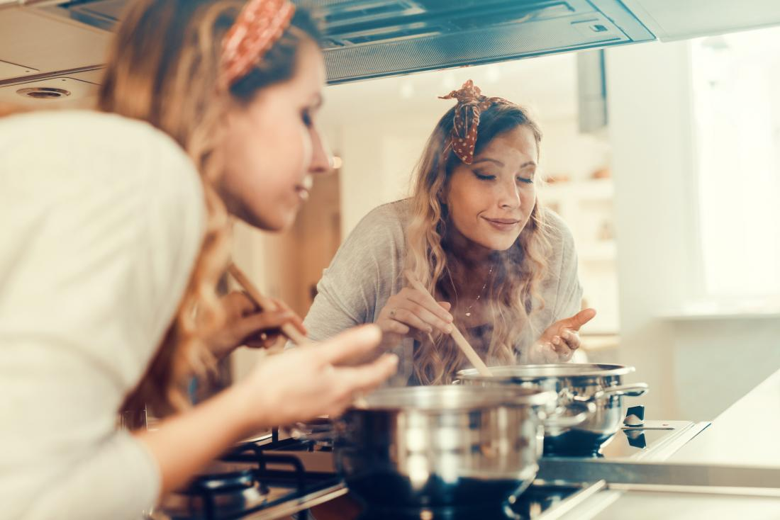 Woman smelling cooking