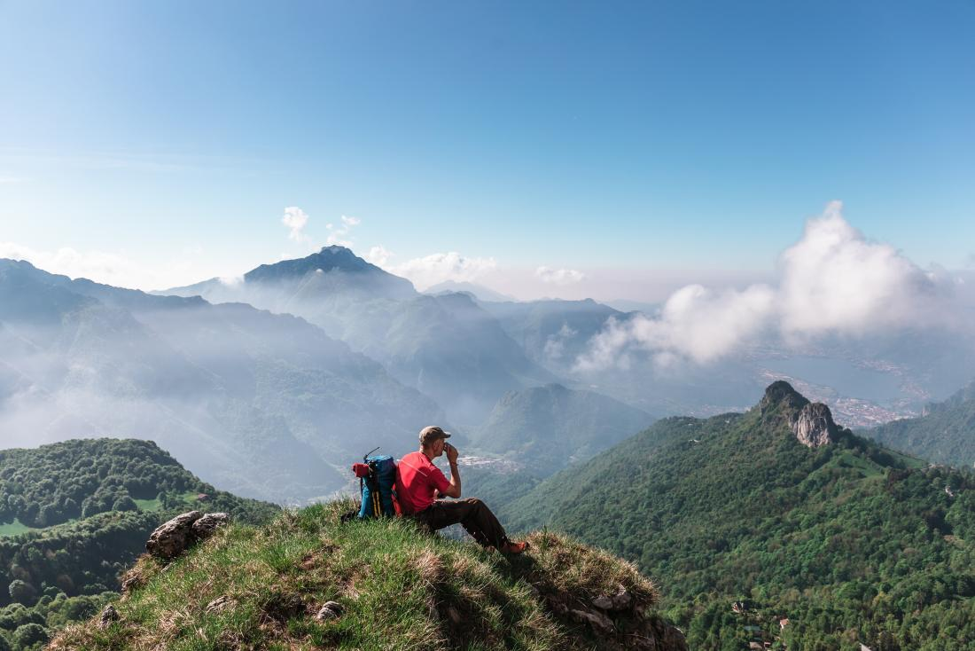 Man hiking in the hills wondering about signs of depression in men