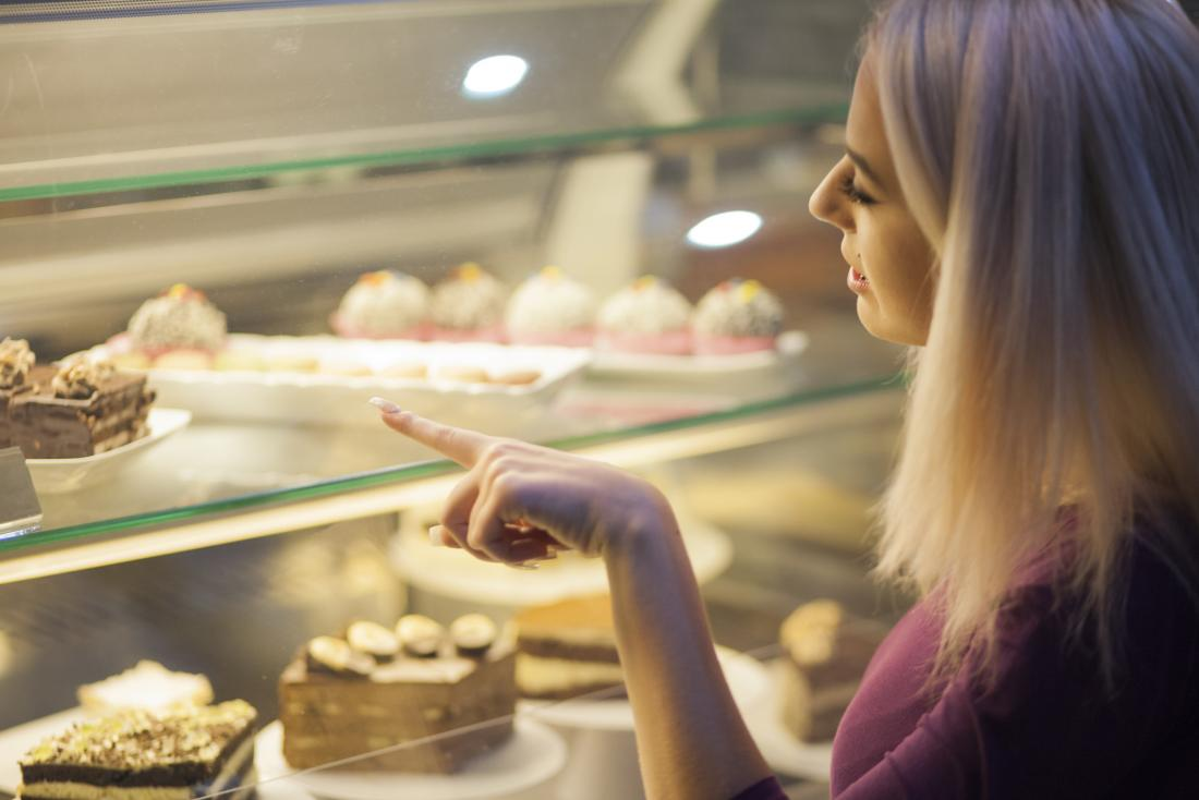 Woman choosing a cake
