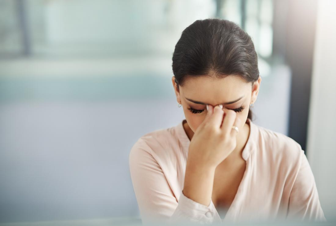 young woman with blurred vision and headache