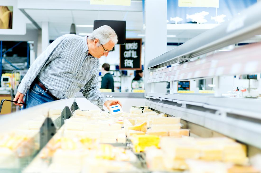 Man buying cheese