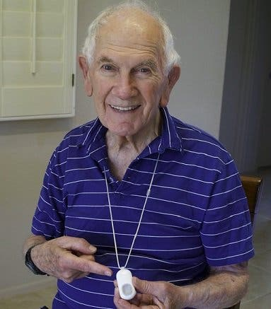 Mr. Dibner, wearing a Lifeline device, at his home in Arizona in 2016. He had memories of a 70-year-old family friend having a stroke and not being found for three days when he was a young man.