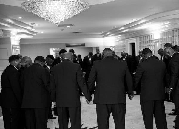 The grooms praying together just before their 2016 wedding ceremony began.