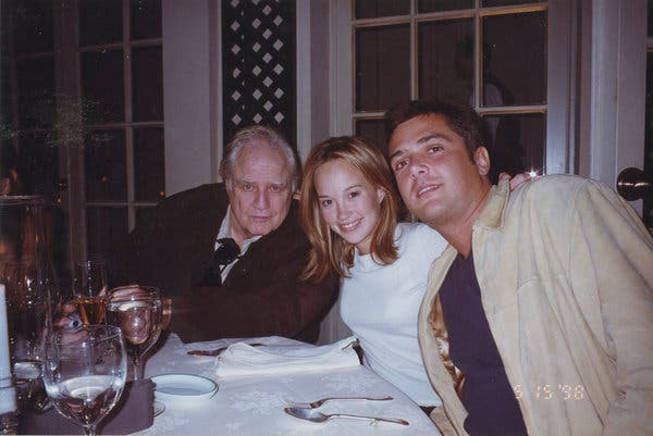 Marlon Brando, far left, dining with Petra Brando Fischer and Russel Fischer in 1998.