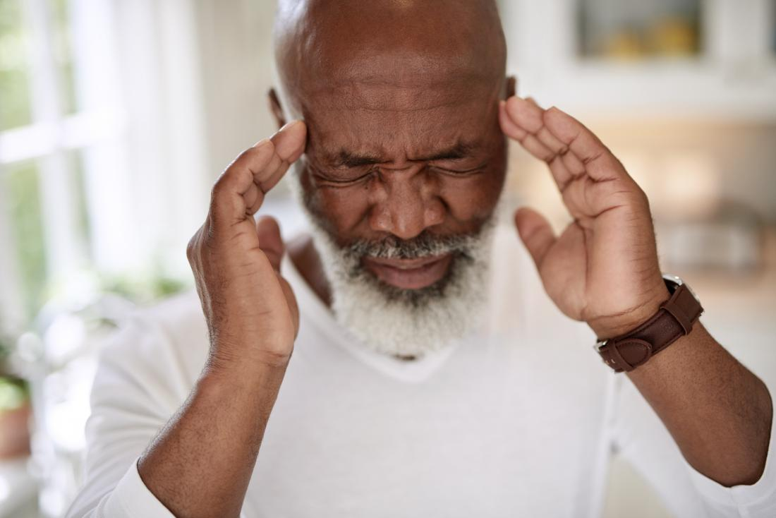 senior man with acute migraine