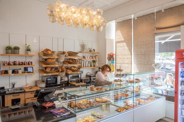 L'Epi Doré, a Portuguese-owned cafe, serves homemade pastries, including the classic Portuguese custard tart known as pastel de nata.