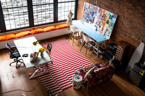 Ms. Reese's Detroit work space, on the second floor of a former warehouse,is as colorful as her work.