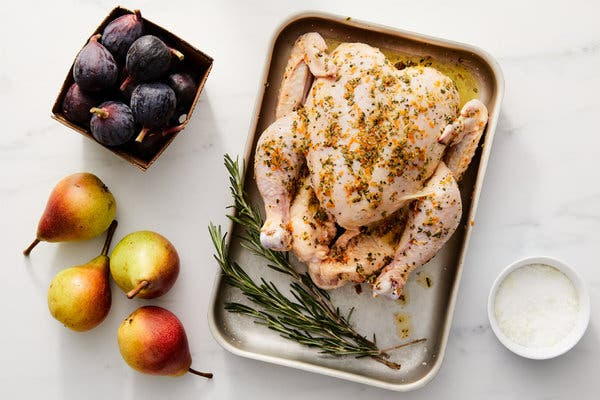 The chicken is rubbed with a marinade ofgarlic, orange zest, rosemary and salt and pepper.